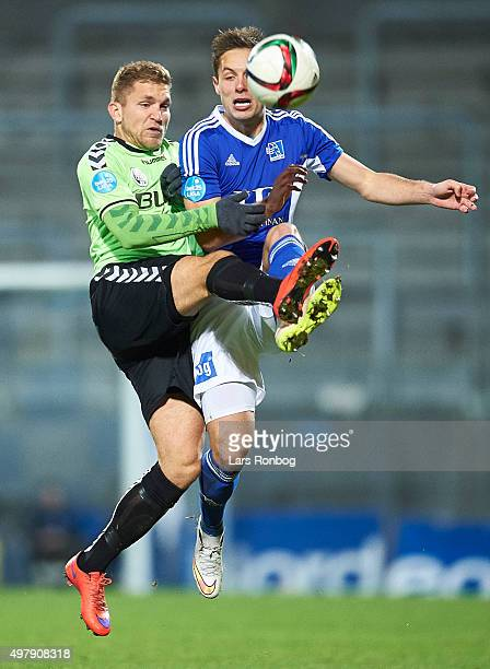 Denis Fazlagic of Vejle Boldklub and Casper Hojer Nielsen of Lyngby Boldklub compete for the ball during the Danish 1th Division Bet25 Liga match...