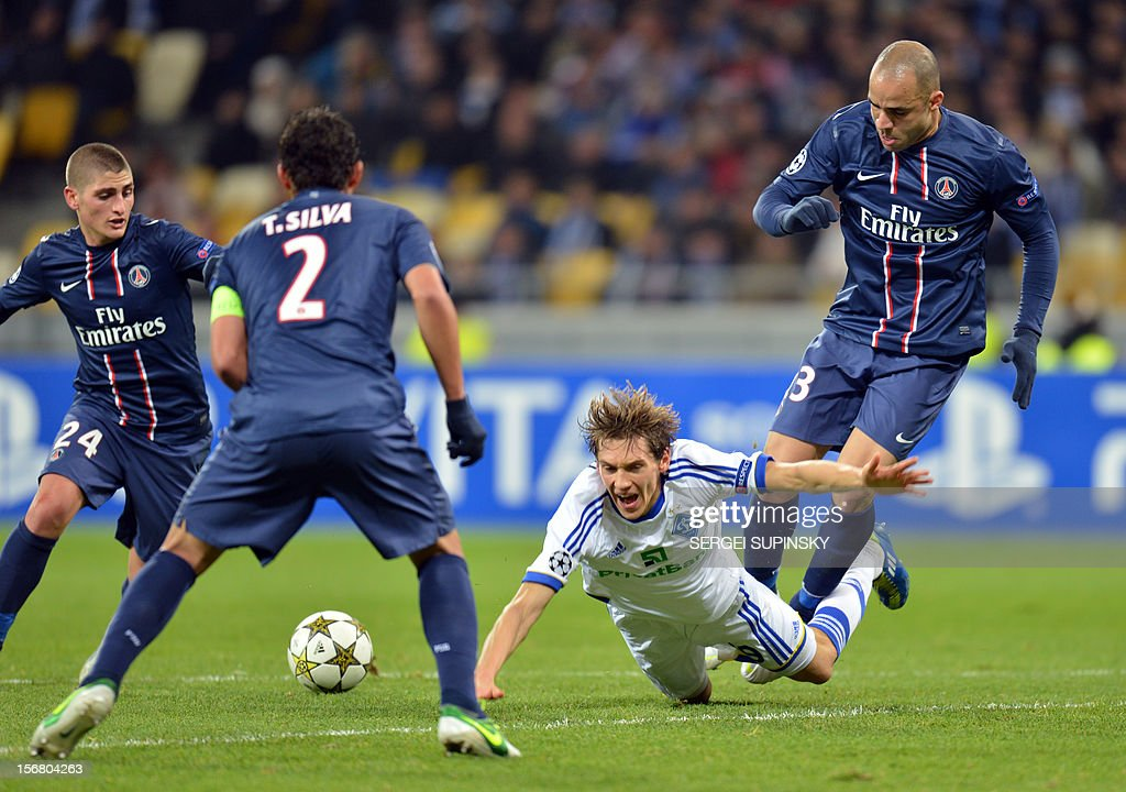 Denis Garmash (2R ) of FC Dynamo Kiev fights for a ball with Gregory van der Wiel (R) , Thiago Silva ( 2L) , and Marco Verratti of Paris Saint-Germain FC during UEFA Champions League, Group A, football match in Kiev on November 21, 2012. AFP PHOTO/ SERGEI SUPINSKY