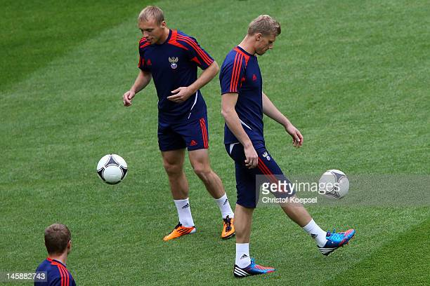Denis Glushakov and Pavel Porgrebnyak of Russia juggle with the ball during a Russia training session prior to the UEFA EURO 2012 Group A opening...