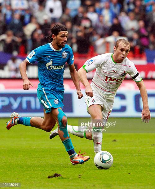 Denis Glushakov of FC Lokomotiv Moscow battles for the ball with Danny of FC Zenit St Petersburg during the Russian Premier League match between FC...