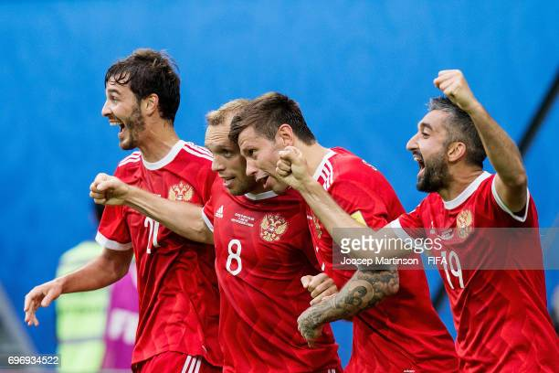 Denis Glushakov of Russia celebrates with team mates after scoring a goal during a group A match between Russia and New Zealand at Saint Petersburg...