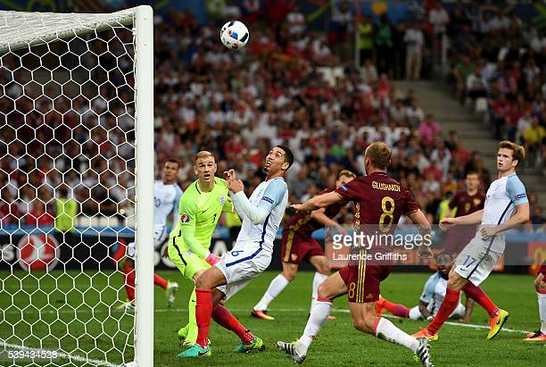 Denis Glushakov of Russia follows the ball into the net as Vasili Berezutski of Russia scores his team's first goal during the UEFA EURO 2016 Group B...