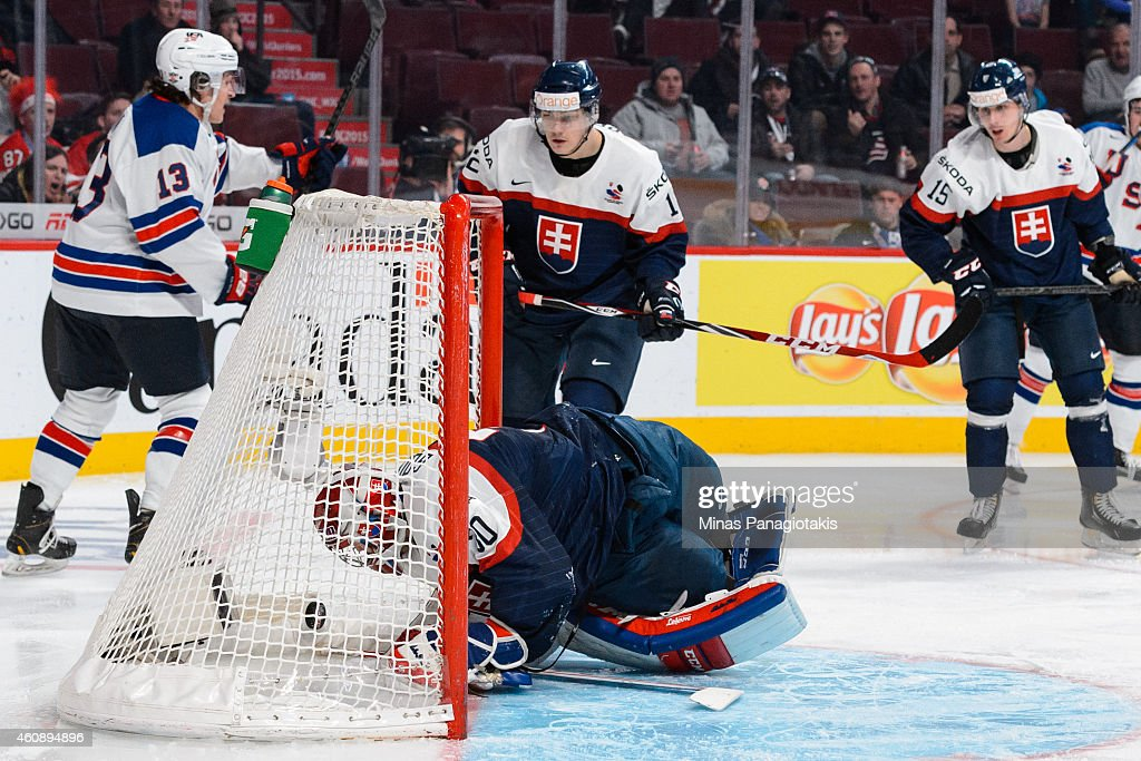 Denis Godla #30 of Team Slovakia allows a goal as he looks at the puck in his net during the 2015 IIHF World Junior Hockey Championship game against Team United States at the Bell Centre on December 29, 2014 in Montreal, Quebec, Canada. Team United States defeated Team Slovakia 3-0.