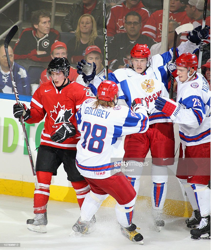Denis Golubev #28, Nikita Dvurechenski #17, and Yevgeni Kuznetsov #25 of Russia celebrate Dvurechenski's goal next to Tyson Barrie #22 of Canada during the 2011 IIHF World U20 Championship Gold medal game between Canada and Russia at the HSBC Arena on January 5, 2011 in Buffalo, New York. Russia won the gold medal with a 5-3 win.