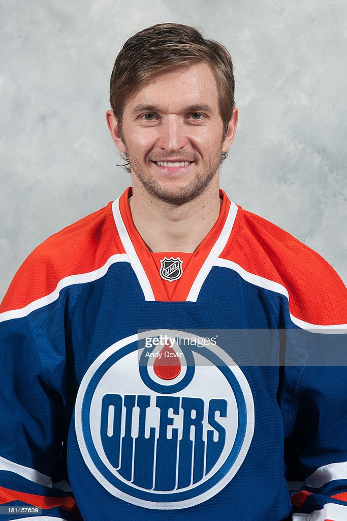 Denis Grebeshkov of the Edmonton Oilers poses for his official headshot for the 2013-2014 NHL season on September 11, 2013 in Edmonton, Alberta, Canada.