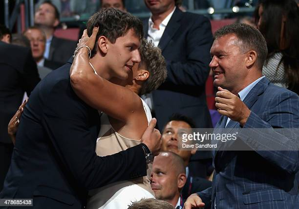 Denis Gurianov is congratulated by family after being picked 12th overall by the Dallas Stars during Round One of the 2015 NHL Draft at BBT Center on...