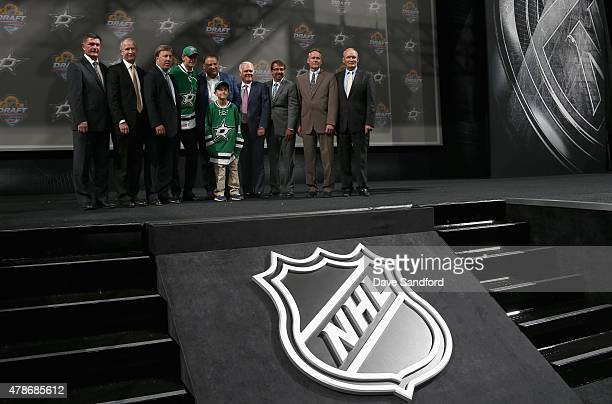 Denis Gurianov poses on stage with team personnel after being picked 12th overall by the Dallas Stars during Round One of the 2015 NHL Draft at BBT...
