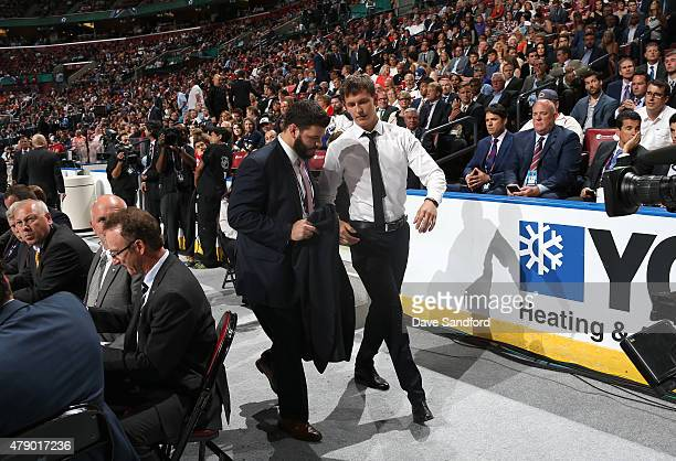 Denis Gurianov walks toward the stage after being selected 12th overall by the Dallas Stars during Round One of the 2015 NHL Draft at BBT Center on...