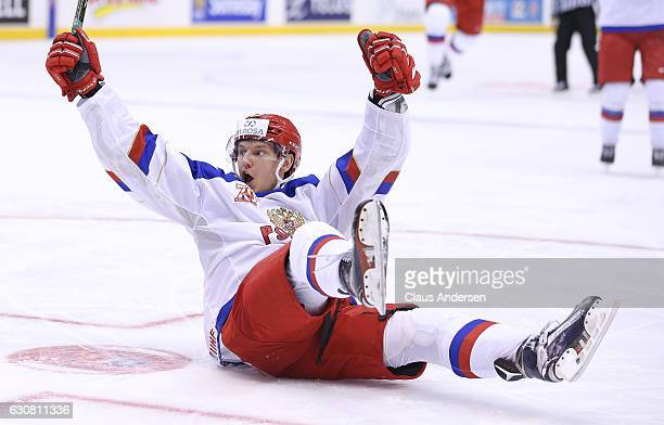 Denis Guryanov of Team Russia celebrates a goal by teammate Pavel Karnaukhov against Team Denmark during a QuarterFinal game at the 2017 IIHF World...