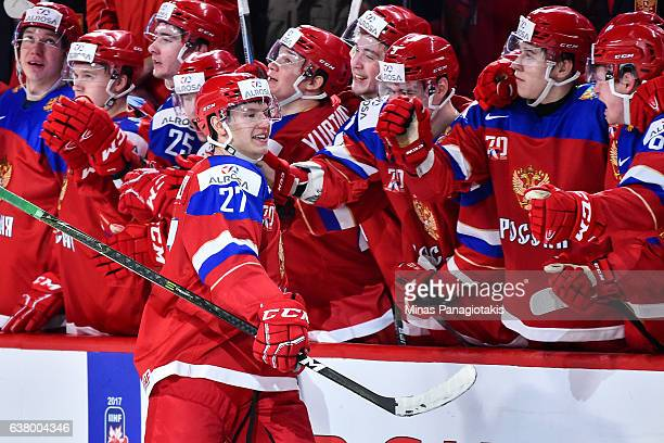 Denis Guryanov of Team Russia celebrates a goal in the shootout with teammates on the bench during the 2017 IIHF World Junior Championship semifinal...
