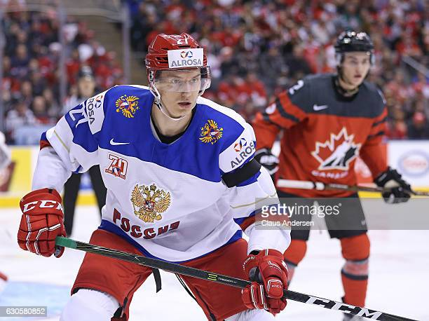 Denis Guryanov of Team Russia defends against Team Canada during a game at the the 2017 IIHF World Junior Hockey Championships at the Air Canada...