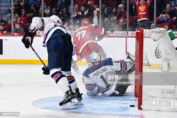 Denis Guryanov of Team Russia scores a game tying goal on goaltender Tyler Parsons of Team United States in the third period during the 2017 IIHF...