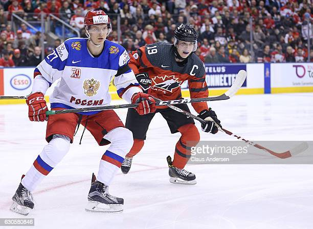 Denis Guryanov of Team Russia skates against Dylan Strome of Team Canada during a game at the the 2017 IIHF World Junior Hockey Championships at the...