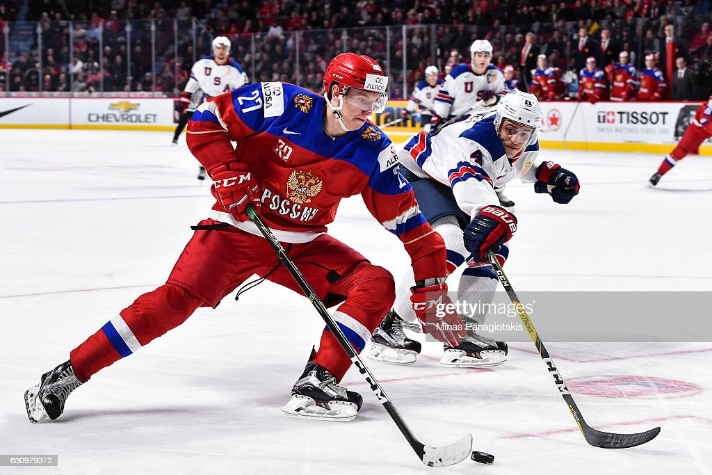 Denis Guryanov #27 of Team Russia skates the puck against Caleb Jones #4 of Team United States during the 2017 IIHF World Junior Championship semifinal game at the Bell Centre on January 4, 2017 in Montreal, Quebec, Canada. The Team United States defeated Team Russia 4-3 in a shootout.