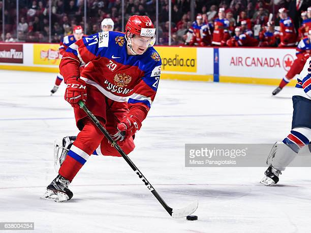 Denis Guryanov of Team Russia skates the puck during the 2017 IIHF World Junior Championship semifinal game against Team United States at the Bell...