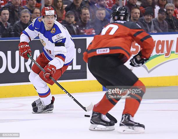 Denis Guryanov of Team Russia skates with the puck against Team Canada during a game at the the 2017 IIHF World Junior Hockey Championships at the...