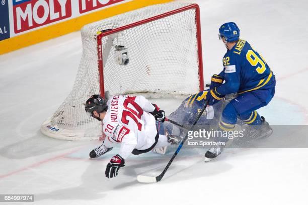 Denis Hollenstein tries to score against Goalie Henrik Lundqvist during the Ice Hockey World Championship Quarterfinal between Switzerland and Sweden...