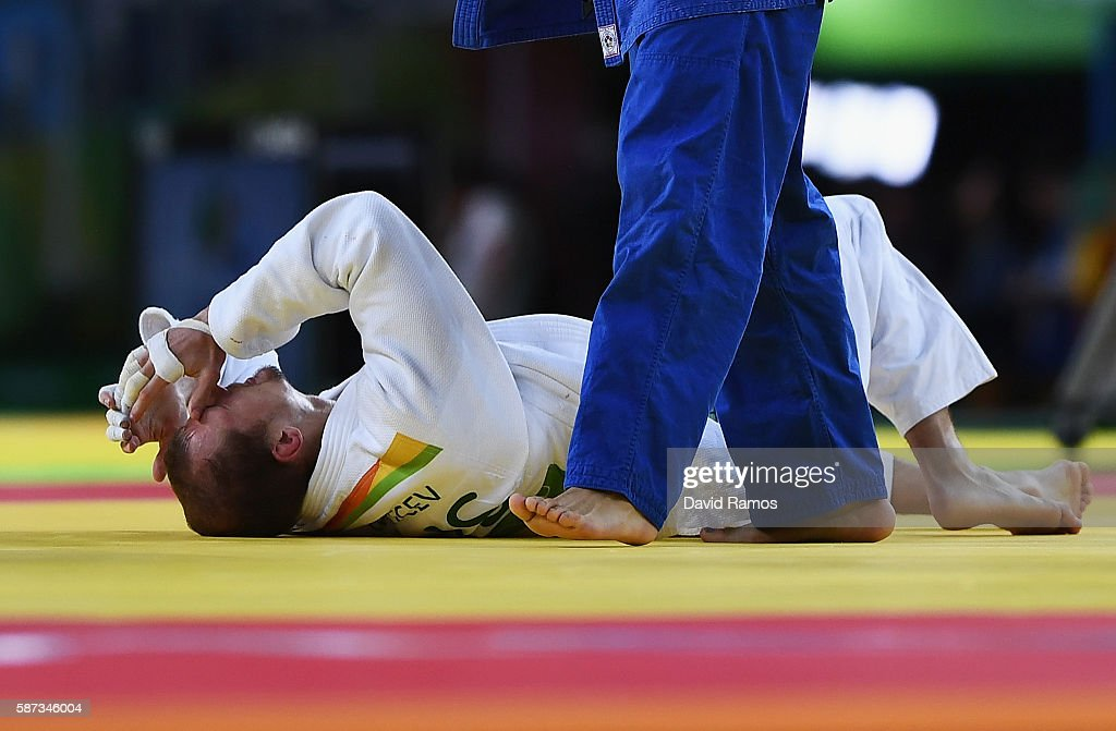 Denis Iartcev of Russia reacts being defeated by Lasha Shavdatuashvili of Georgia in the Men's 73 kg Repechage contest on Day 3 of the Rio 2016...