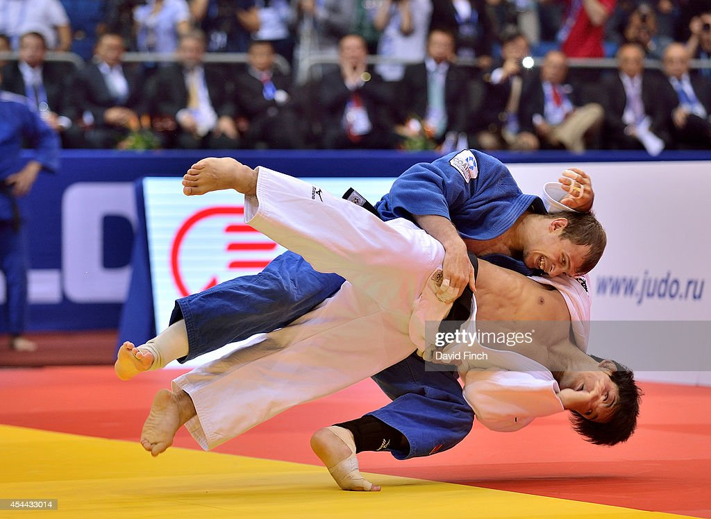 Denis Iartcev of Russia (blue) throws <a gi-track='captionPersonalityLinkClicked' href=/galleries/search?phrase=Shohei+Ono&family=editorial&specificpeople=8840237 ng-click='$event.stopPropagation()'>Shohei Ono</a> of Japan for a yuko (5 points) but was unable to stop the Japanese team beating Russia for the gold medal during the Chelyabinsk Judo World Championships at the Sport Arena 'Traktor' on August 31, 2014 in Chelyabinsk, Russia.