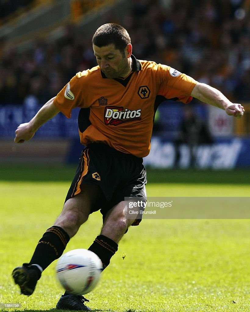 Denis Irwin of Wolverhampton Wanderers strikes the ball during the Nationwide First Division match between Wolverhampton Wanderers and Leicester City held on May 4, 2003 at the Molineux Stadium in Wolverhampton, England. The match ended in a 1-1 draw.