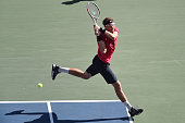 Denis Istoman of Uzbekistan in action during men's singles quater final match against Milos Raonic of Canada on day five of Rakuten Open 2014 at...