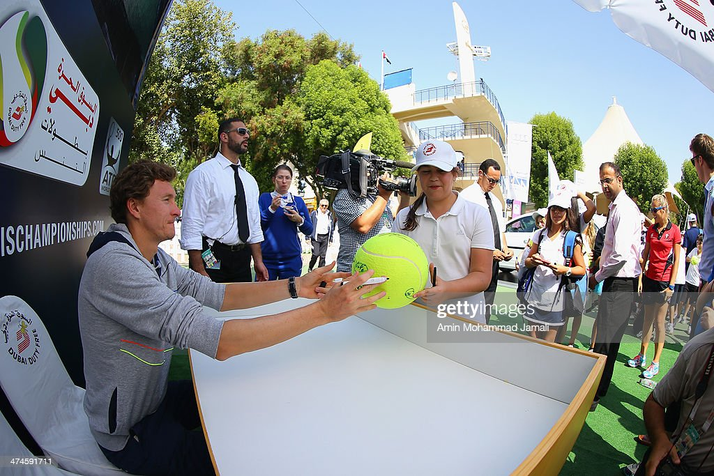 Denis Istomi of Uzbekistan meets fans and signs autographs during the ATP Dubai Duty Free Tennis Championship on February 24, 2014 in Dubai, United Arab Emirates.