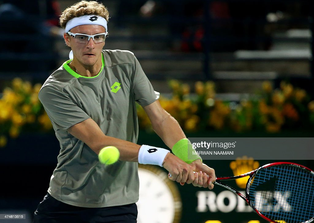 Denis Istomim of Uzbekistan returns the ball to Novak Djokovic of Serbia during their tennis match in the second day of the Dubai Duty Free Tennis Championships on February 25, 2014.