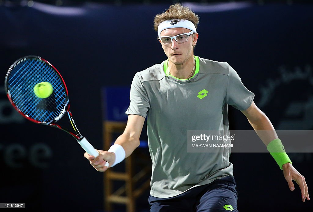 Denis Istomim of Uzbekistan returns the ball to Novak Djokovic of Serbia during their tennis match in the second day of the Dubai Duty Free Tennis Championships on February 25, 2014. AFP PHOTO/MARWAN NAAMANI