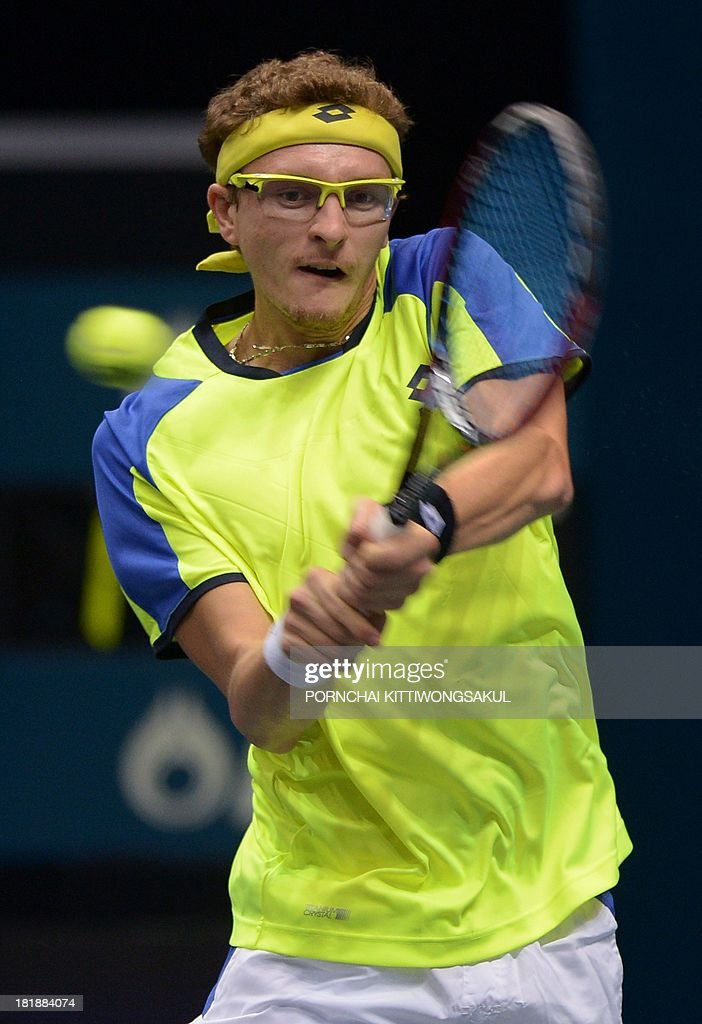 Denis Istomin of the Ukraine hits a return to Mikhail Youzhny of Russia during the second round of Tennis ATP Thailand Open 2013 tournament in Bangkok on September 26, 2013. Youzhny beat Istomin 6-3, 6-3.