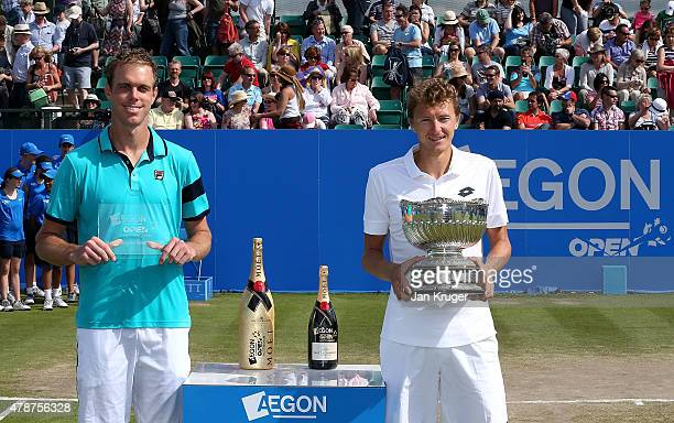 Denis Istomin of Uzbekistan and runner up Sam Querrey of the United States pose after the mens singles final match on day seven of the Aegon Open...