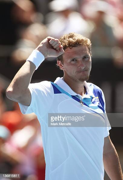 Denis Istomin of Uzbekistan celebrates victory in his quarter final match against Richard Gasquet of France during day five of the 2012 Sydney...