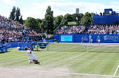 Denis Istomin of Uzbekistan celebrates victory over Sam Querrey of USA during the mens singles final match on day seven of the Aegon Open Nottingham...