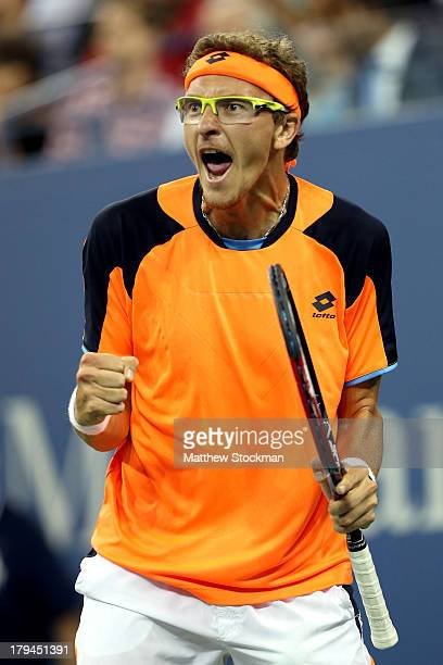Denis Istomin of Uzbekistan celebrates winning the first set during his men's singles fourth round match against Andy Murray of Great Britain on Day...