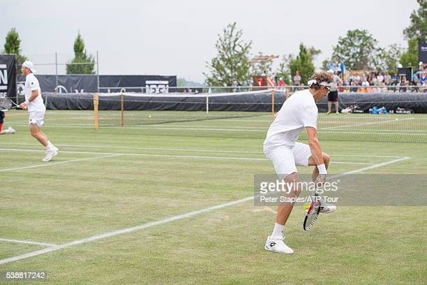 Denis Istomin of Uzbekistan doing a tweener with doubles partner Illya Marchenko of Ukraine in action against Bob Mike Bryan of the USA at the ATP...
