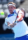 Denis Istomin of Uzbekistan hits a backhand during his semi final match against Jarkko Nieminen of Finland during day six of the 2012 Sydney...