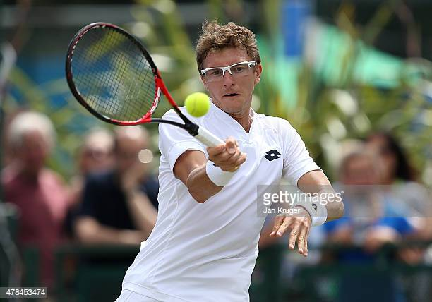 Denis Istomin of Uzbekistan in action against Leonardo Mayer of Argentina during their quarter final match on day five of the Aegon Open Nottingham...