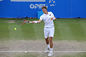 Denis Istomin of Uzbekistan in action against Marcos Baghdatis of Cyprus during their semi final match on day six of the Aegon Open Nottingham at...