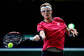 Denis Istomin of Uzbekistan in action against Richard Gasquet of France during day 1 of the BNP Paribas Masters held at the at Palais Omnisports de...