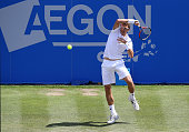 Denis Istomin of Uzbekistan in action against Sam Querrey of USA during the mens singles final match on day seven of the Aegon Open Nottingham at...