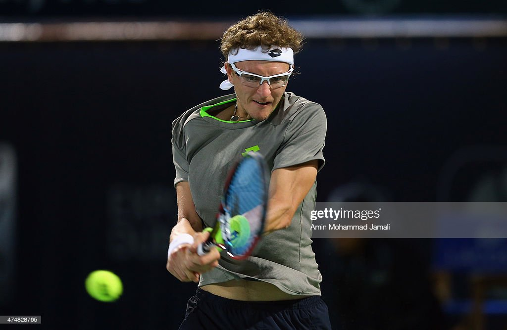 Denis Istomin of Uzbekistan in action during his first match against <a gi-track='captionPersonalityLinkClicked' href=/galleries/search?phrase=Novak+Djokovic&family=editorial&specificpeople=588315 ng-click='$event.stopPropagation()'>Novak Djokovic</a> of serbia on day 2 of the Dubai Duty Free Tennis ATP Championships on February 25, in Dubai, United Arab Emirates.