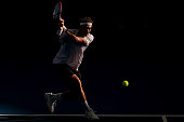 Denis Istomin of Uzbekistan plays a backhand during his match against Lleyton Hewitt of Australia on day five of the Brisbane International at Pat...