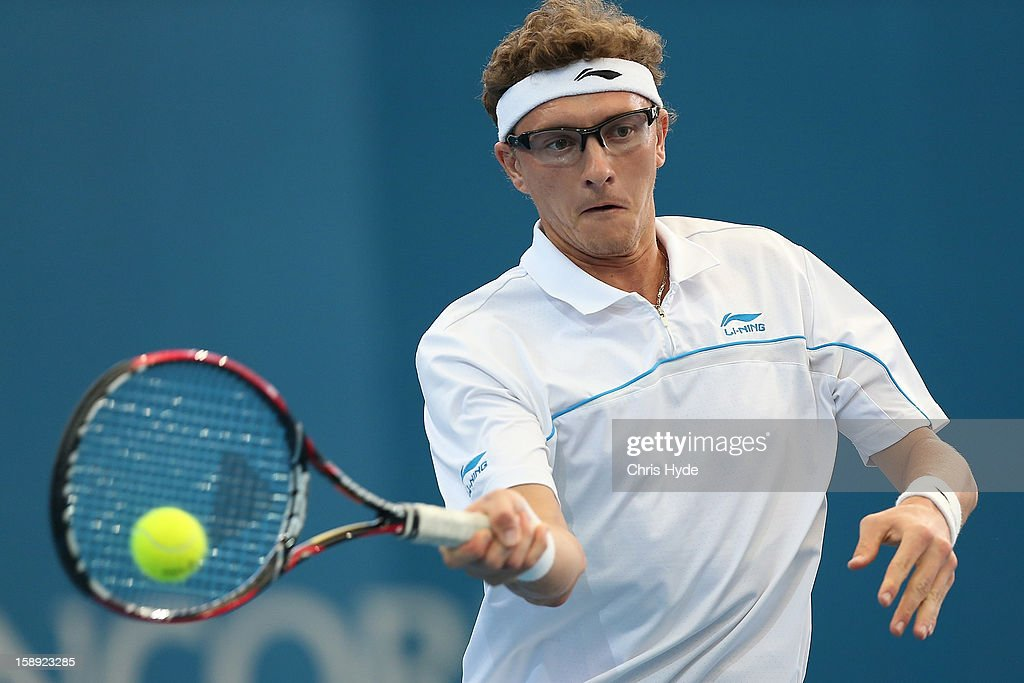 Denis IstomIn of Uzbekistan plays a backhand during his match against Andy Murray of Great Britain on day six of the Brisbane International at Pat Rafter Arena on January 4, 2013 in Brisbane, Australia.