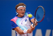 Denis Istomin of Uzbekistan plays a backhand during his match against Philipp Kohlschreiber of Germany during the BMW Open on April 29 2014 in Munich...