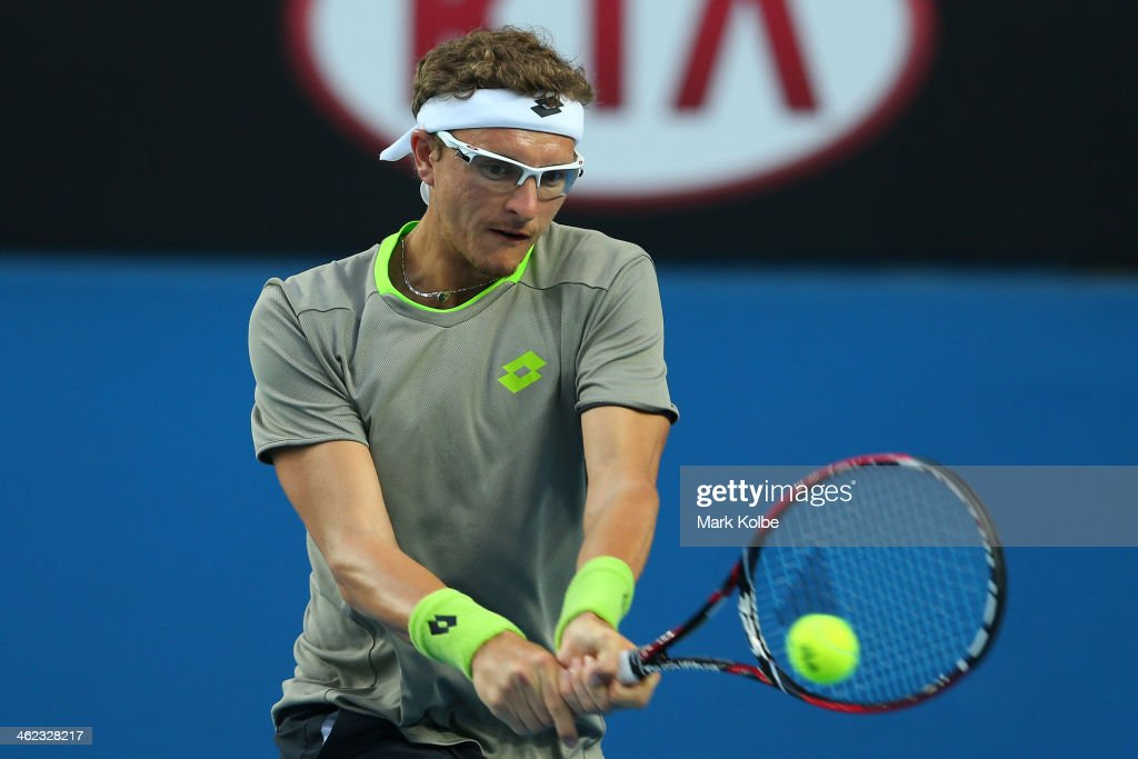 Denis Istomin of Uzbekistan plays a backhand in his first round match against Marcos Baghdatis of Cyprus during day one of the 2014 Australian Open at Melbourne Park on January 13, 2014 in Melbourne, Australia.