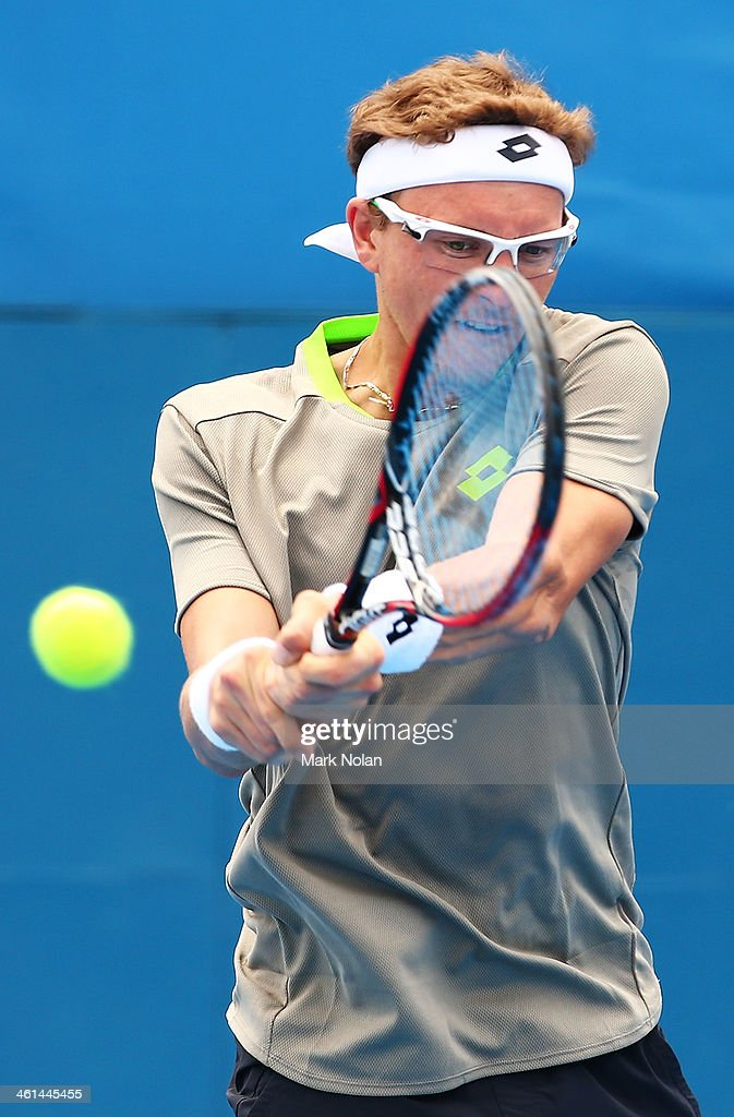 Denis Istomin of Uzbekistan plays a backhand in his match against Dmitry Tursunov of Russia during day five of the 2014 Sydney International at Sydney Olympic Park Tennis Centre on January 9, 2014 in Sydney, Australia.