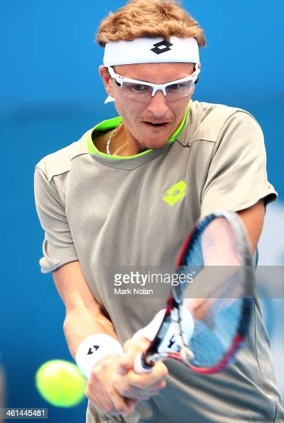 Denis Istomin of Uzbekistan plays a backhand in his match against Dmitry Tursunov of Russia during day five of the 2014 Sydney International at...