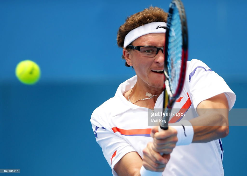 <a gi-track='captionPersonalityLinkClicked' href=/galleries/search?phrase=Denis+Istomin&family=editorial&specificpeople=553792 ng-click='$event.stopPropagation()'>Denis Istomin</a> of Uzbekistan plays a backhand in his second round match against Fernando Verdasco of Spain during day four of the Sydney International at Sydney Olympic Park Tennis Centre on January 9, 2013 in Sydney, Australia.