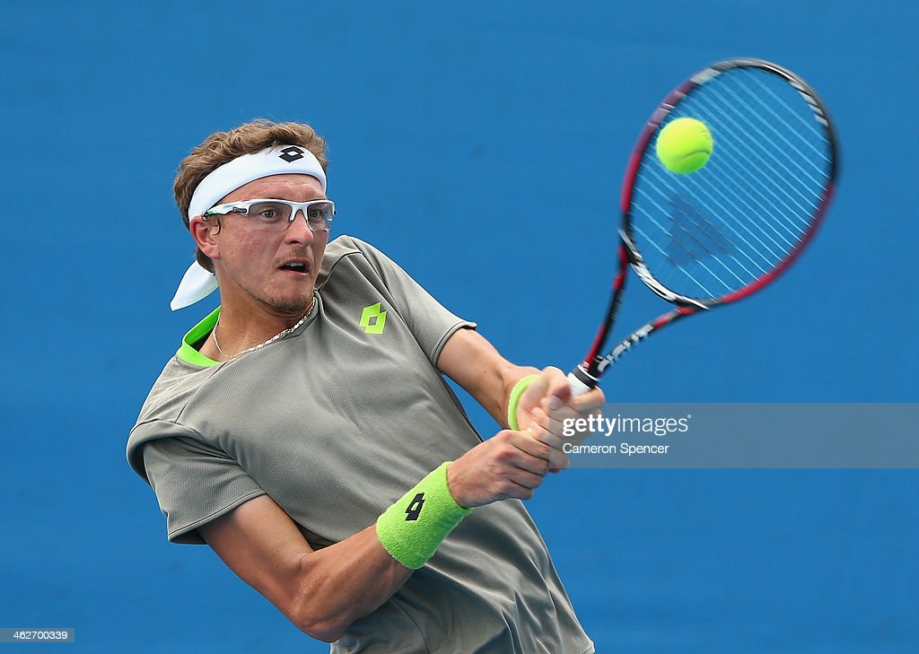 Denis Istomin of Uzbekistan plays a backhand in his second round match against Dmitry Tursunov of Russia during day three of the 2014 Australian Open at Melbourne Park on January 15, 2014 in Melbourne, Australia.