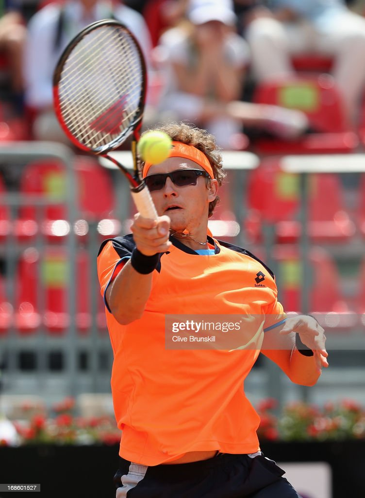 <a gi-track='captionPersonalityLinkClicked' href=/galleries/search?phrase=Denis+Istomin&family=editorial&specificpeople=553792 ng-click='$event.stopPropagation()'>Denis Istomin</a> of Uzbekistan plays a forehand against John Isner of the USA in their first round match during day one of the Internazionali BNL d'Italia 2013 at the Foro Italico Tennis Centre on May 12, 2013 in Rome, Italy.