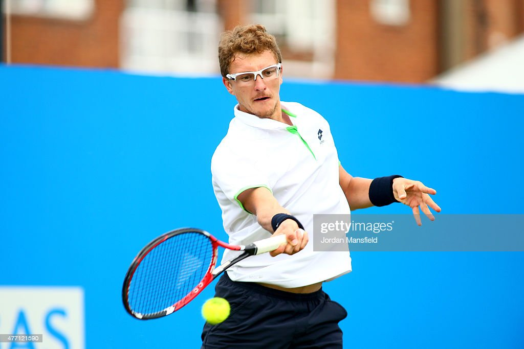 Denis Istomin of Uzbekistan plays a forehand during his Qualification match of the Aegon Championships against Yen-Hsun Lu of Taiwan at Queens Club on June 14, 2015 in London, England.